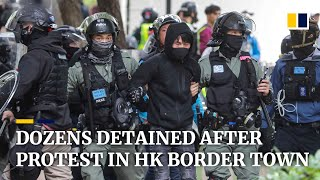 Dozens detained by police after march against parallel traders in Hong Kong's Sheung Shui